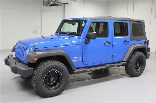 Pre-Owned 2012 Jeep Wrangler Unlimited Sport 4x4