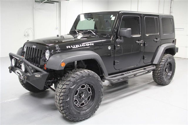 Pre-Owned 2011 Jeep Wrangler Unlimited Rubicon 4x4 With Navigation